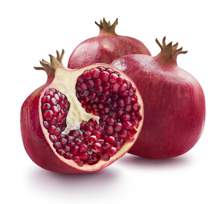 Two whole and one half of pomegranate isolated