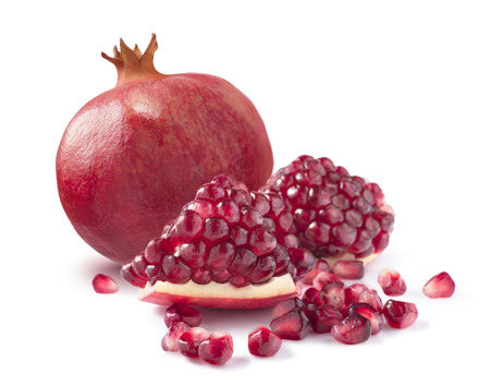 One whole pomegranate and piece isolated on white background as package design elements photo