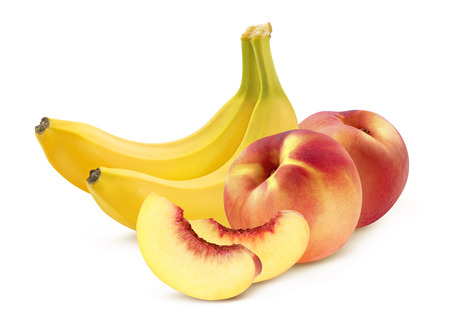 Banana and peach pieces isolated on white background as package design element photo
