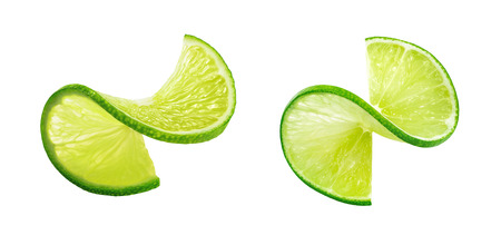 Fresh lIme slice twist isolated on white background as package design element Foto de archivo