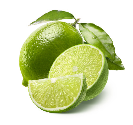 lime green background: Whole lime, half and quarter slice isolated on white background as package design element Stock Photo