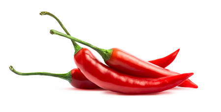 Three chili peppers isolated on white background as package design element photo