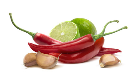 Red hot chilie pepper, garlic cloves, lime ingredients isolated on white background as package design element Archivio Fotografico