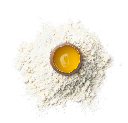 Fresh egg in wheat flour isolated on white background as package design element Stock Photo