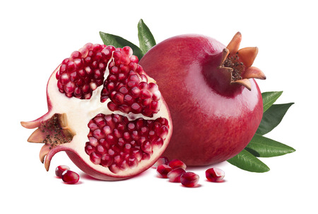 Red whole pomegranate and half piece with leaves isolated on white background as package design element