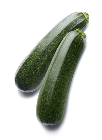 Zucchini vertical isolated on white background as package design element