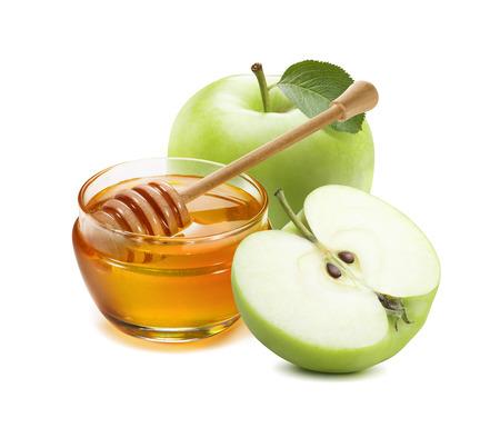 Glas des grünen Apfels und des Honigs für das jüdische neue Jahr getrennt auf weißem Hintergrund Standard-Bild - 85059800