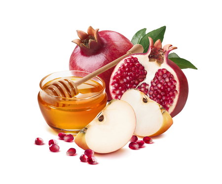 Red apple, pomegranate and honey jar for Jewish New Year isolated on white background for poster design