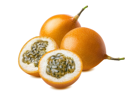 Granadilla. Whole yellow passion fruit and slices isolated on white background