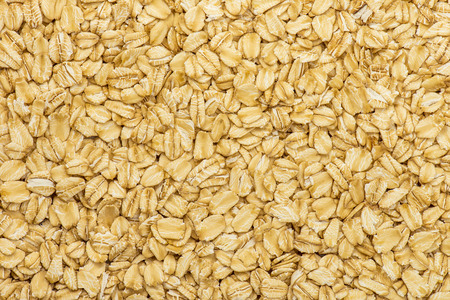 Oatmeal texture. Rolled oat flakes background Stock Photo
