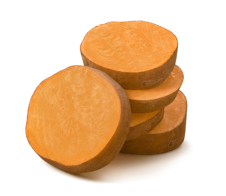Pile of sweet potato round slices isolated on white background. Package design element. \ Standard-Bild