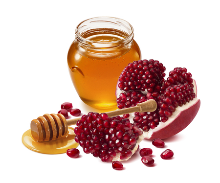 Pomegranate and honey jar isolated on white background. Design element with clipping path Stockfoto