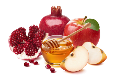 Jewish New Year composition. Pomegranate, red apple and honey isolated on white background. Package design element with clipping path Reklamní fotografie - 106183326