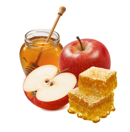 Red apple, honecomb and honey jar isolated on white background. Composition for jewish new year with clipping path