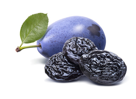 Blue fresh and dry plums isolated on white background. 写真素材