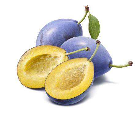 Whole blue plum and halves isolated on white background. Banco de Imagens