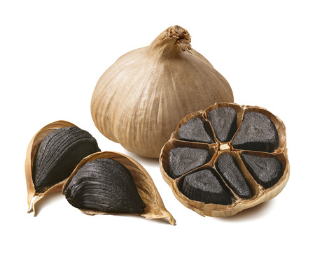 Tasty black garlic isolated on white