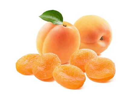 Two fresh apricots and dry ones with green leaf isolated on white background. Package design element with clipping path