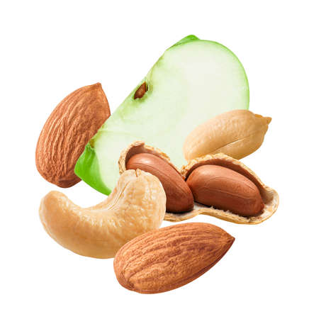 Flying almonds, cashew, peanuts and slice of green apple isolated on white background. Package design element
