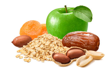Green apple, peanuts, dates, dry apricots and rolled oat flakes isolated on white background.