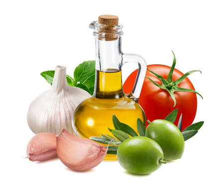 Bottle of olive oil, garlic, tomato, green olives and basil leaves isolated on white background. Traditional dressing ingredients. Package design element with clipping path Foto de archivo