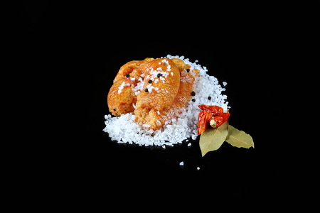 Delicious caviar, roe closeup, pike caviar flat lay on sea white salt, red hot pepper, laurel leaves on a black background, top view, set.