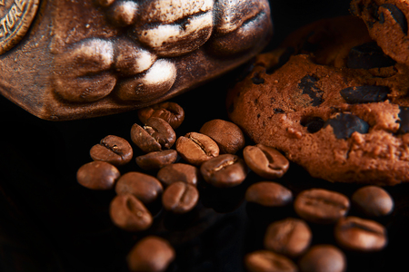 close-up round crunchy chocolate cookies with coffee beans on a black background, macro, set.