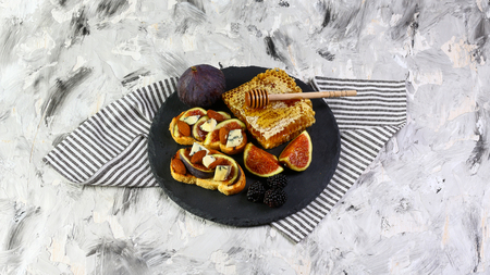 bruschetta with prosciutto ham figs with cheese. italian appetizer. Flat lay. Top view. Authentic lifestyle image. Seasonal harvest crop local produce concept. Stock Photo