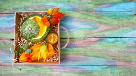 Pumpkin Cream Soup and Juice Fresh in a Box, Seasonal harvest crop local produce concept. Authentic lifestyle. top view, place for text.. Stock Photo
