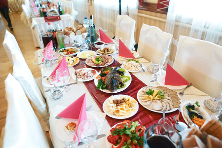 Catering service. Restaurant table with food on the table. Plates of food. Dinner time, lunch.