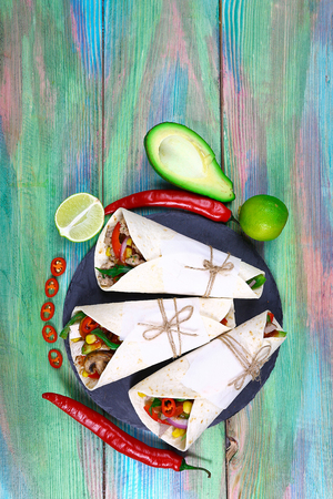 tacos with meat and vegetables - Mexican food style.