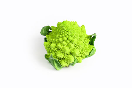 Creative layout made of romanesco cauliflower. Flat lay. Food concept. Romanesco broccoli on the white background. Top view, place for text. Stock Photo