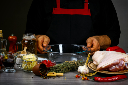 Bavarian pork knuckle with sauerkraut, sharp chili sauce and beer in cooking process preparing food. cooking recipe.