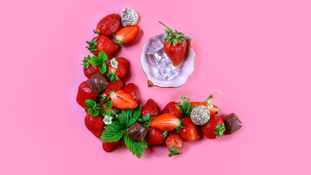 Top of view fresh strawberry and chocolate Isolated on pink background. Healthy food. free space for text. Stock fotó