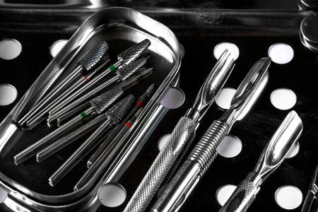 Professional manicure tools. Closeup Of Nail Care Tools. set of metallic manicure tools macro sterilization, disinfection.