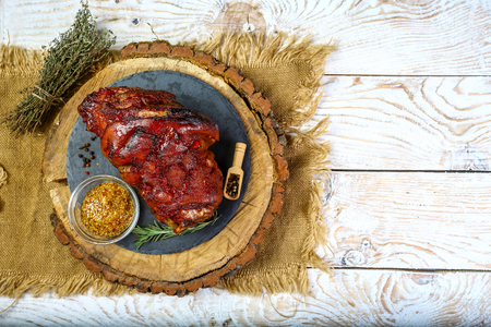 Roasted pork knuckle eisbein on wooden cutting board with Text area for design menu restaurant Stok Fotoğraf