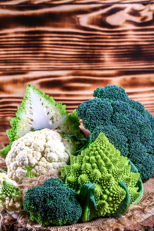 fresh raw green broccoli on wooden background, Authentic lifestyle image. Low-calorie nutritional products. Stockfoto