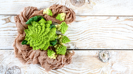 Romanesco broccoli close up. The fractal vegetable is known for it's connection to the fibonacci sequence and the golden ratio. Fun food for any practical scientists that loves mathematics.