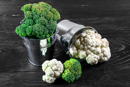 Collection of broccoli and cauliflower on the kitchen table.