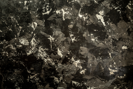 Closeup of dark grunge textured background. space for text. top view.