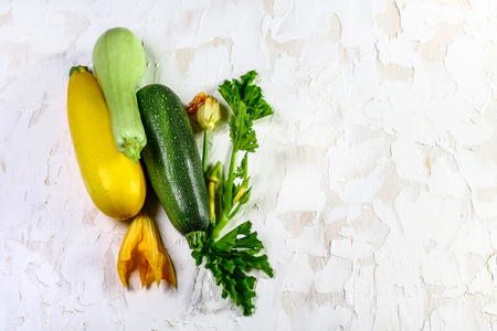 Fresh zucchini with blossom, healthy vegan diet or vegetarian food, cooking concept. Top view, place for text.