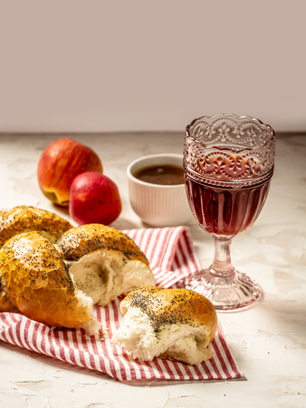 Traditional jewish bread brown challah on black wooden background with fruits and honey. Jewish pastries. Flat lay Stock Photo