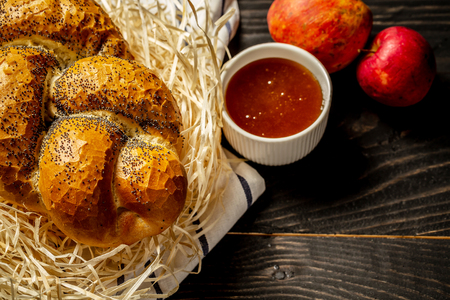 Side view on Shabbat challah. braided loaf of bread flour with fruits and honey. Jewish pastries. Flat lay. Stock Photo