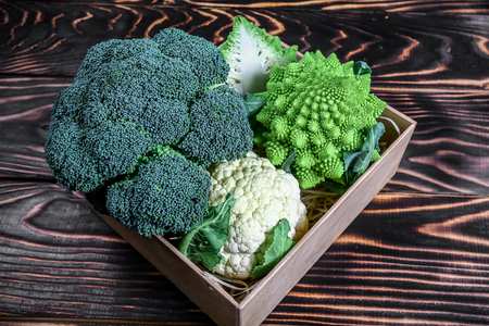 Collection of Romanesco broccoli and cauliflower on the kitchen table. top view.