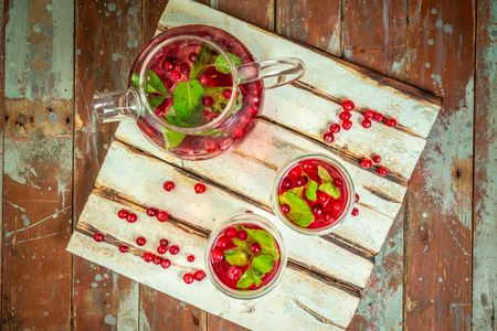 Cranberries infused sassi water for detox, healthy eating in bottles. Top view. Healthy food, drinks, fitness, healthy nutrition diet concept. Standard-Bild - 122243821
