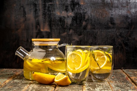 Lemonade with fresh lemon on wooden background. Summer drink, lemonade. Diet. Copy space. Reklamní fotografie