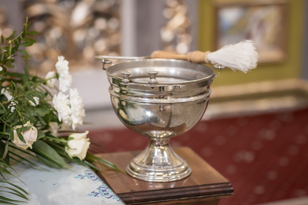 attributes of an Orthodox priest for baptism. Baptism in the font. Sacrament of baptism. Child and God. Christening.