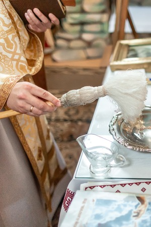 The sacrament of baptism. Attributes of an Orthodox priest for baptism. Baptism in the font. Child and God. Holy water.