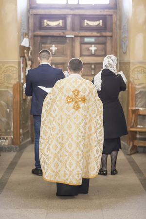 The sacrament of baptism. Attributes of an Orthodox priest for baptism. baptism Christening the baby. Child and God.