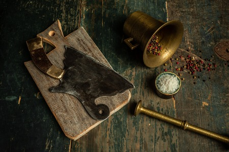 Vintage kitchenware kitchen utensils Meat Butcher Cleaver on wooden background with copy space. Food concept.